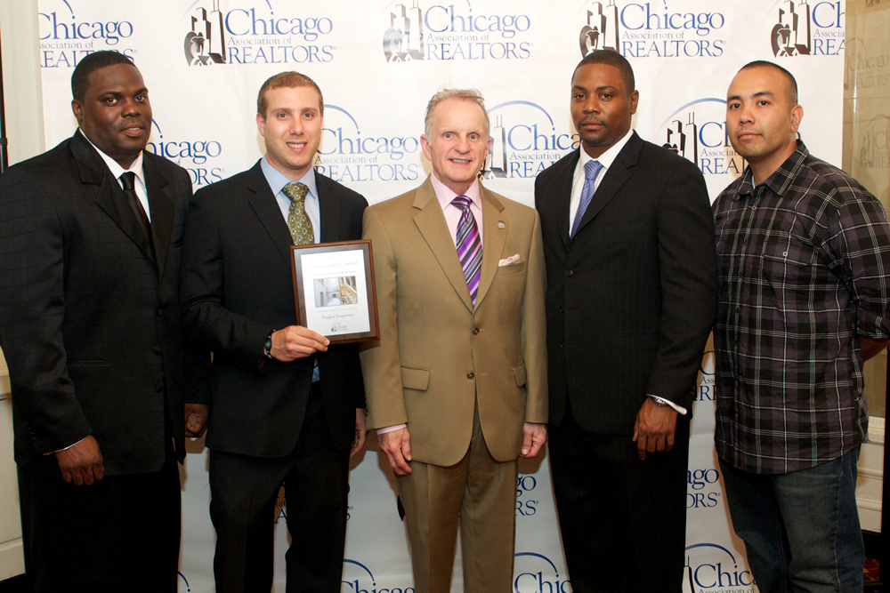 "Hard work pays off — our team picking up a GNA award for ""Upstanding Rehab & Redevelopment in Chicago Neighborhoods."""