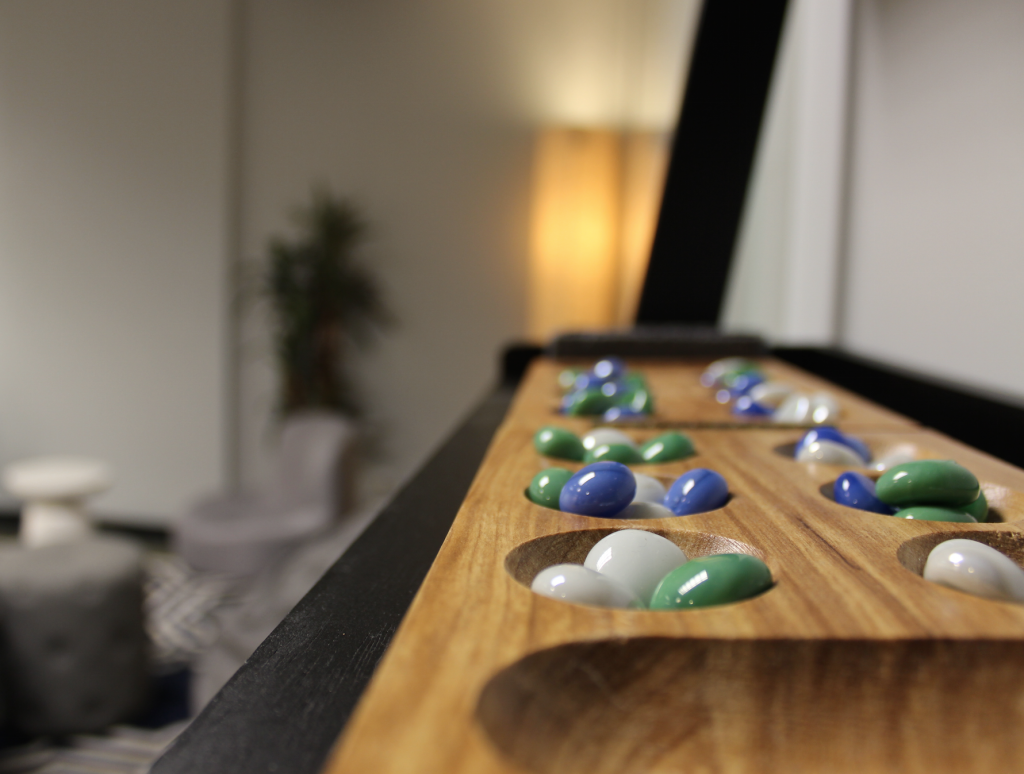 You name it, we've got it. Between foosball, ping pong, a boxing machine, a kegerator and even Mancala (pictured here), there's no lack of things to keep you occupied at Pangea.