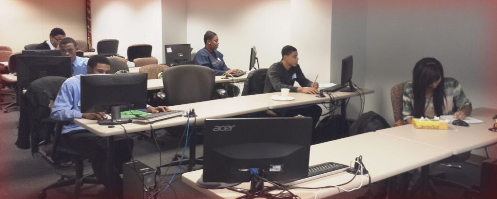 2013 Interns working on a presentation&nbsp;<br/><br/><span style='font-size: .7em; color: #868686; font-weight: bold;'>December 2014 | Contact Center</span>